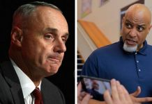 Rob Manfred y Tony Clark