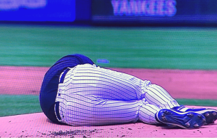 New York Yankees pitcher, Masahiro Tanaka hit by line drive from Giancarlo Stanton.