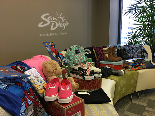 SDTA team donated gifts to four families, as part of the Alpha Project.