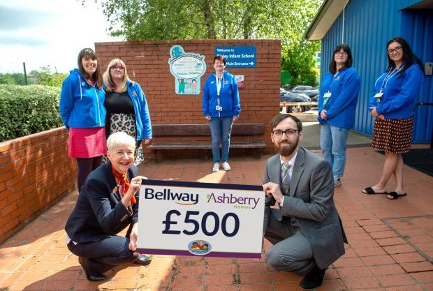 Left to right (back) - Jade Gent, Michelle Bell, Paula Doleman, Kerry Dennis and Louise Dove of Ripley Infant School with Rebecca Lawrence of Bellway and Ben Docherty of Ashberry Homes (front) CEM-35a509c3