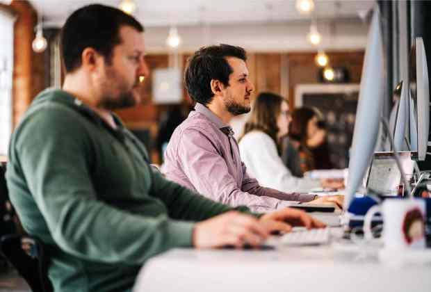Fluid Ideas staff in the agency's studio-ca7d4118