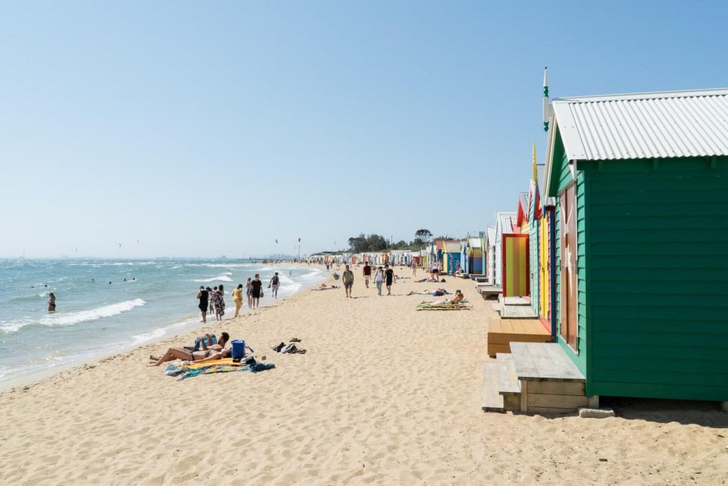The colourful beach boxes lining Brighton Beach