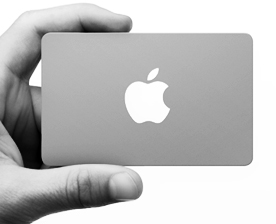 Apple Store Gift Card held in man's hand by thumb and index finger B/W