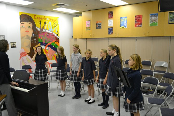 The sixth grade chorus class, including students Kiley Hatch, Maddy Conroy, Lily James, Julia Cipollone, Emma Pelletier, Caroline Dauchess and Grace Talbott, practice one of their more challenging pieces, Laudate Dominum.