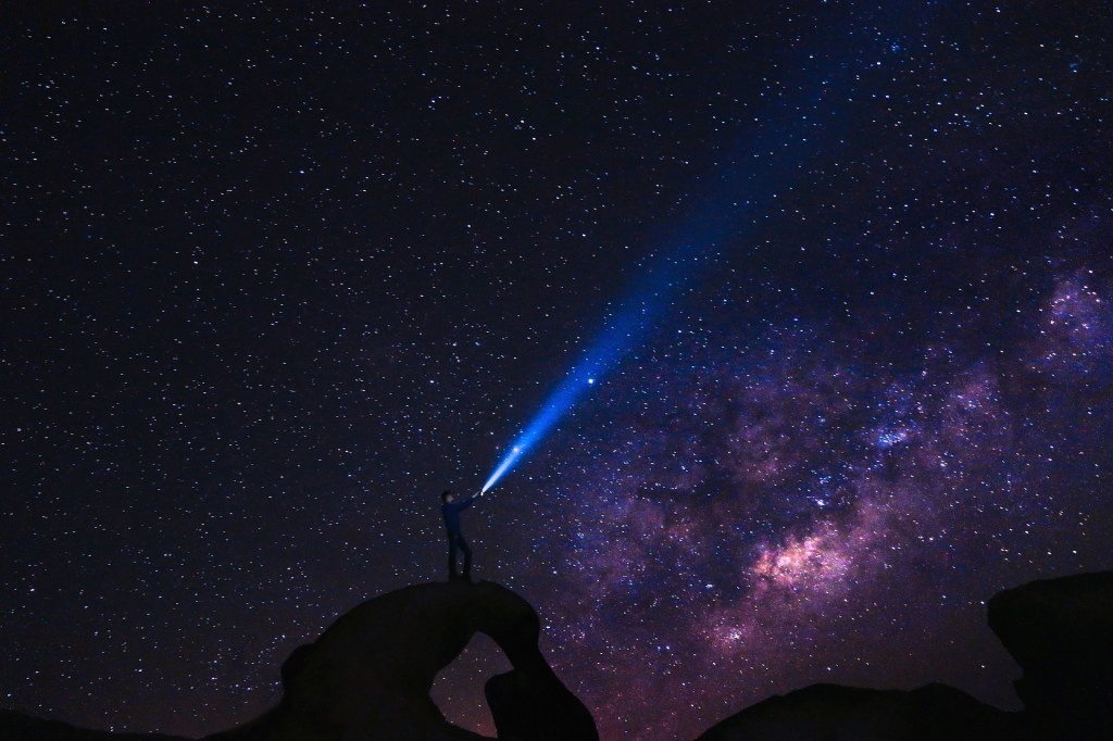 person in galaxy light to follow spiritual calling