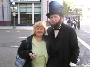 Connie Wilson posing with man dressed as Abraham Lincoln