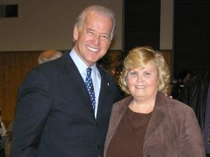 Connie Wilson standing with Joe Biden.