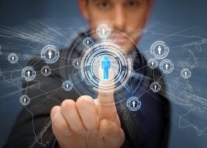 business, technology, internet and social networking concept - businessman pressing button with contact on virtual screens