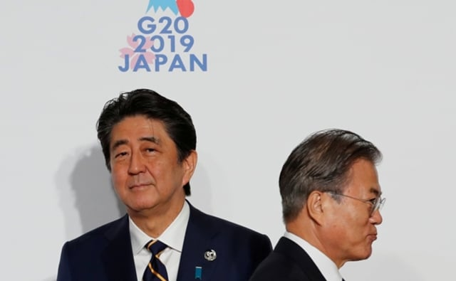 Shinzo Abe y Moon Jae-in