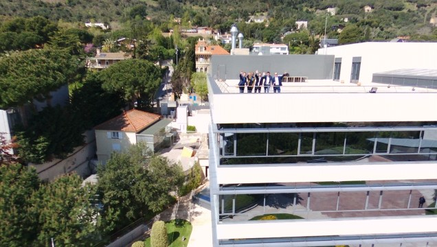 IESE EMBA Leadership Communications team waving
