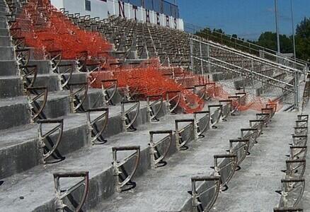 Run down stadium with exposed concrete.