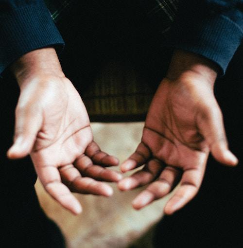 Man's hands meditating | mindfulness | Conscious Content