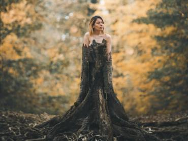 Woman emerging from rooted tree trunk into forest | Ayurvedic spring cleanse Kapha dosha | Conscious Content horiz 1024