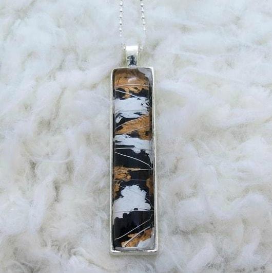 rtoiseshell-whisker-pendant