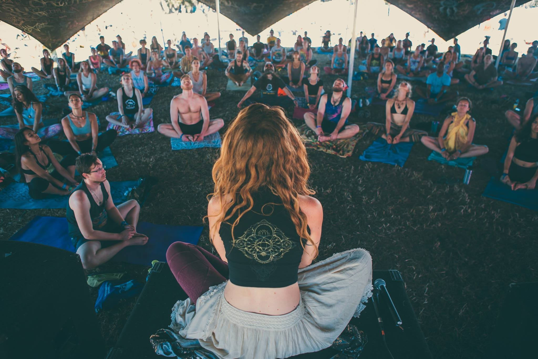 Okeechobee yoga instructor leads festival attendees in a group meditation