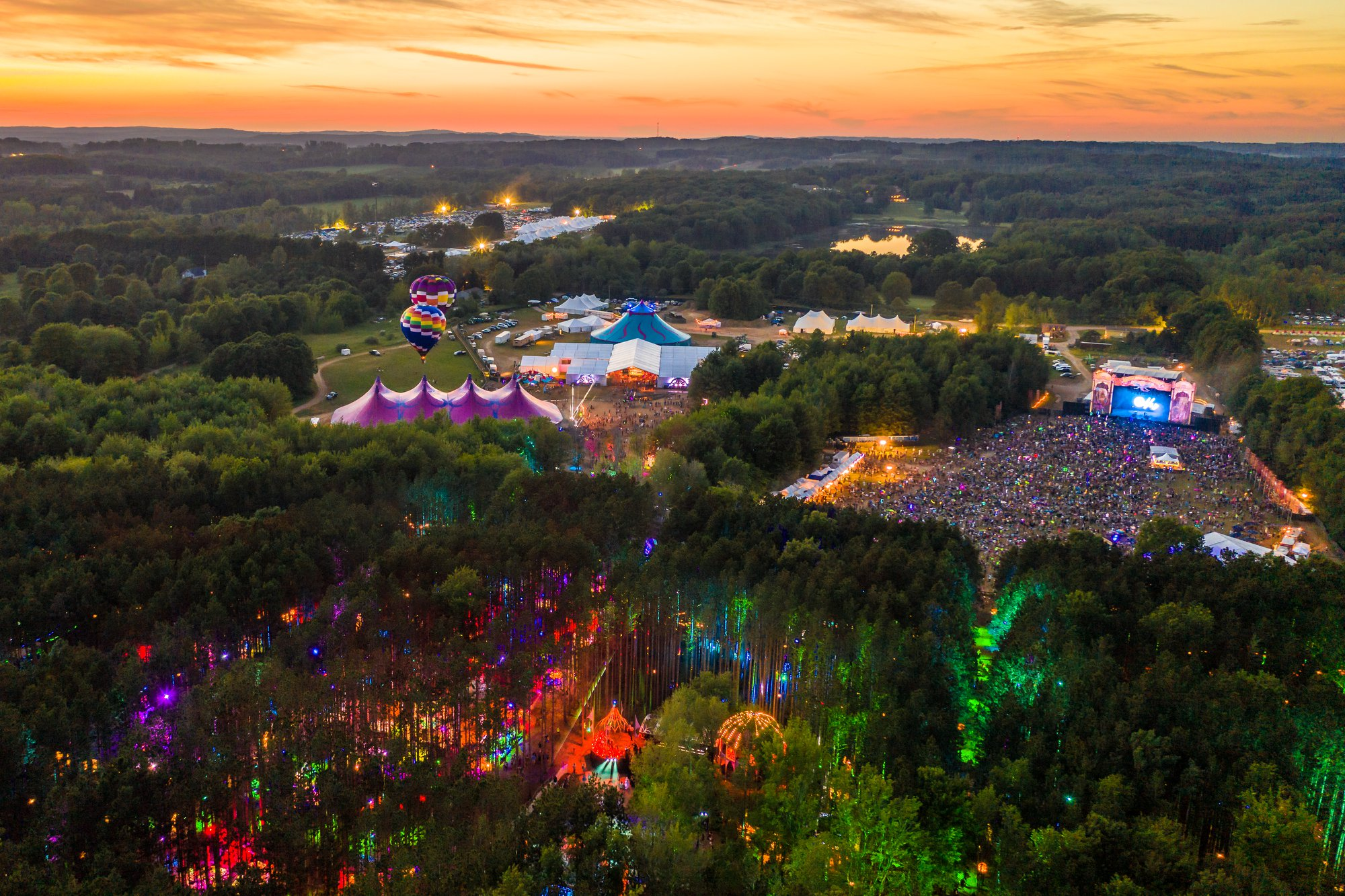 Aerial sunset view of JJ Double Ranch - Sherwood Forest, Tripolee tent, and Sherwood Court stage