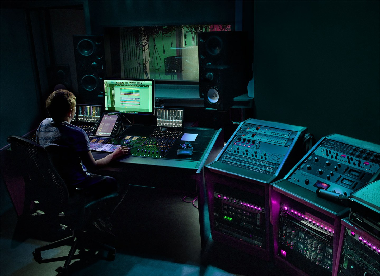 music producer sits in music studio