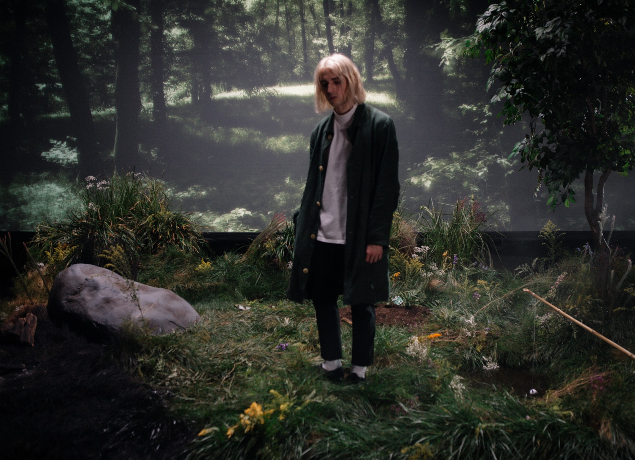 """Porter Robinson stands in a nature scenery in """"Something Comforting"""" music video"""