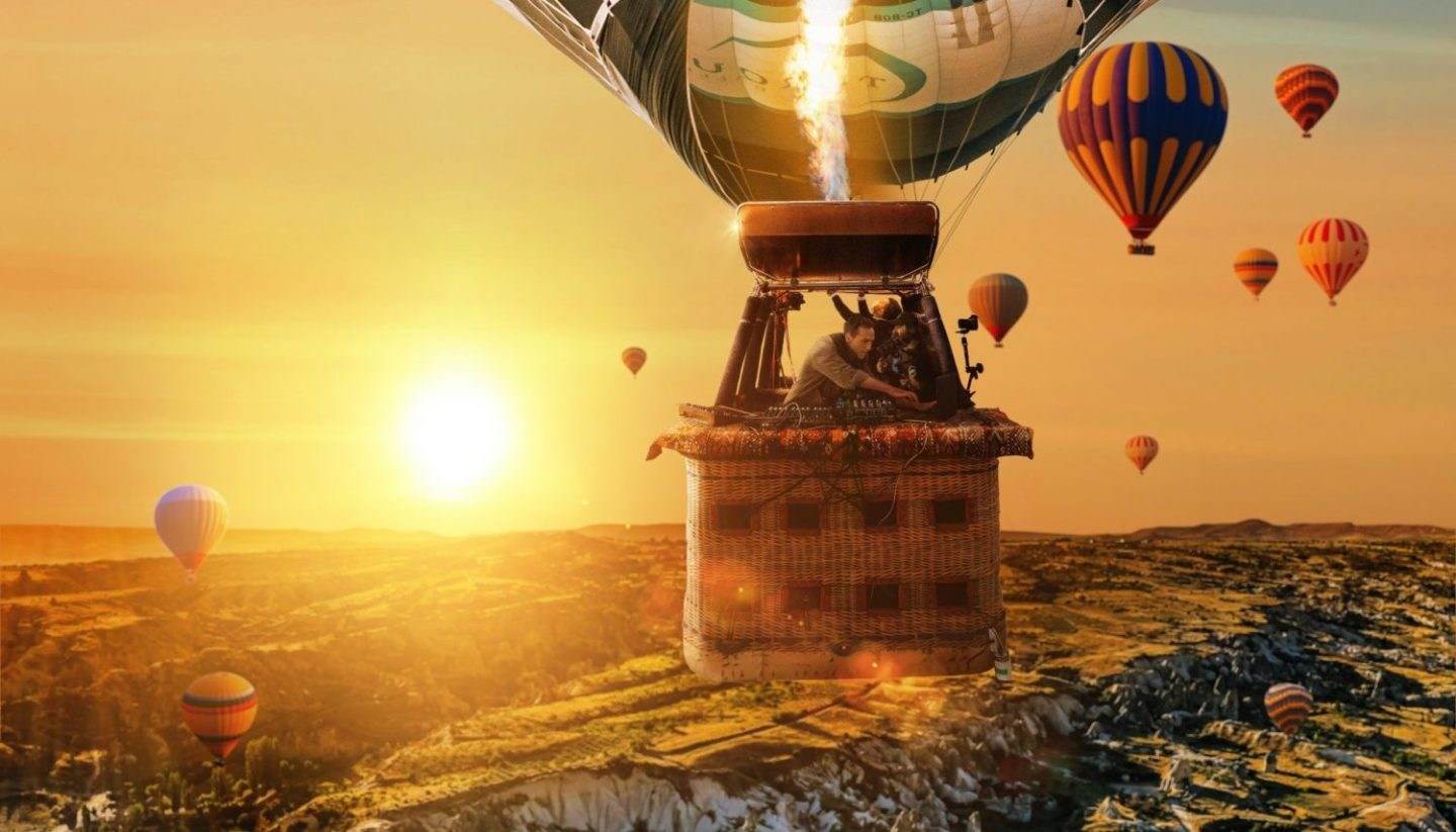 Ben Bohmer sunrise set in hot air balloon sprawling mountain landscapes