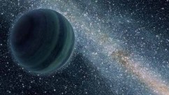 This artist's conception illustrates a giant planet floating freely without a parent star. Astronomers recently uncovered evidence for such lone worlds, thought to have been booted from developing star systems. The sun may have captured such a planet, which new work shows may reside at the edge of the solar system.