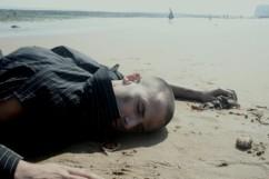 O2-Man lying on beach