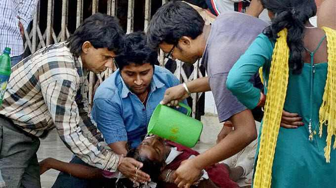 Nepal-earthquake-aftermath-men-pouring-water-on-woman-featured