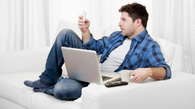 man-on-computer-and-cell-phone