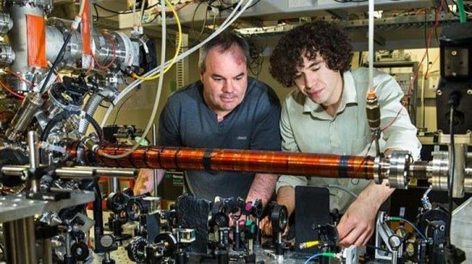 Australian National University Associate Professor Andrew Truscott (L) with Ph.D. student Roman Khakimov. Credit: Stuart Hay, ANU