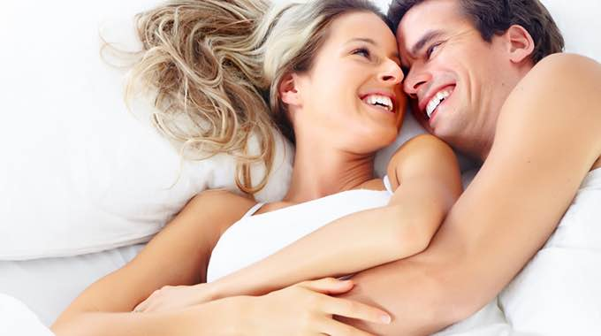 couple happy in bed comp
