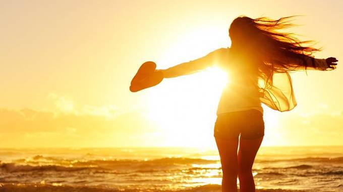 woman celebrates sunrise