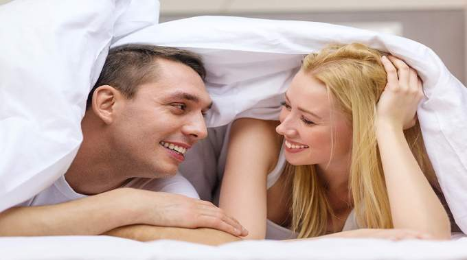 Happy couple in bed-compressed