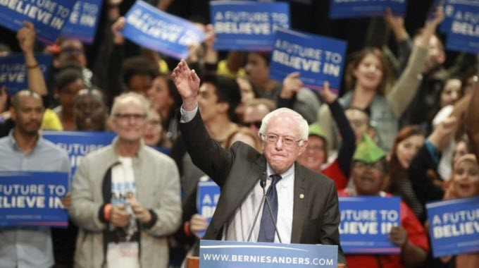 Democratic presidential candidate Bernie Sanders waves to the crowd as he prepares to speak to thousands of supporters at the downtown convention center Tuesday, March 22. (Photo: Hayne Palmour IV — San Diego Union-Tribune)