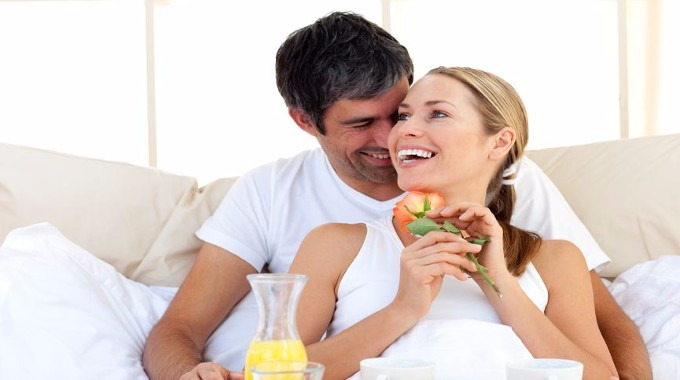 Beautiful couple in hotel room-compressed