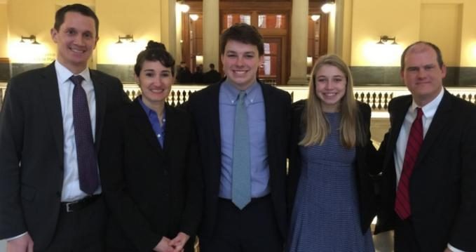 Two of the Massachusetts youth plaintiffs, Shamus Miller and Olivia Gieger, accompanied by their lawyers, Phelps Turner, Jennifer Rushlow, and Dylan Sanders, after a hearing in January. (Photo: Our Children's Trust)