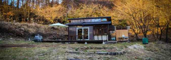 Japanese Tiny Cabin (Built for $16K!) is Off-Grid, Full of Light, and Has Two Indoor Hammocks