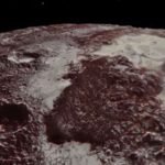 Watch: Flyover Of Pluto's Majestic Mountains and Icy Plains [Close-Up Video Footage]