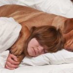 Letting Your Dog Sleep With You Is Good for Chronic Pain Sufferers, New Study Says