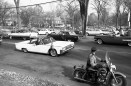 President Kennedy driving by the Amherst town common, October 1963. (image 63-001-8 neg 29)