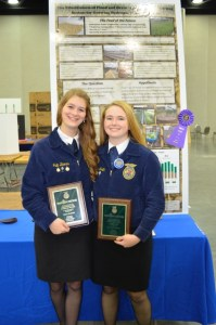Allison Smith and Julia Barnes proudly display their awards.