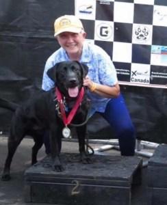 Rains with her dog, Drake, an award winning dock diver.