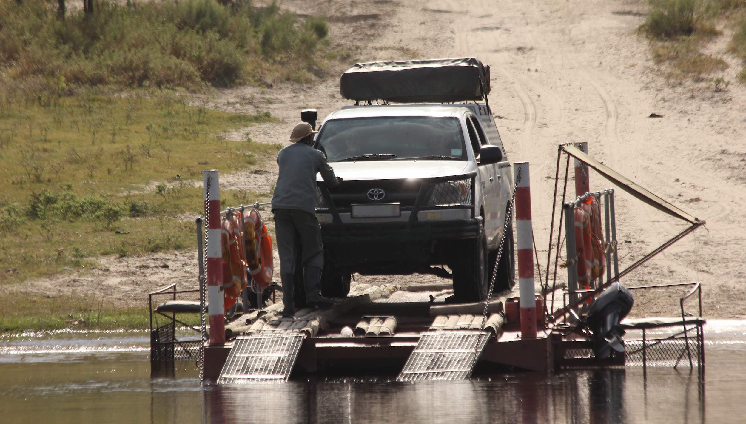 A Toyota bakkie prepares to cross the Boteti river on the local ferry.