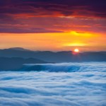 http://www.dreamstime.com/stock-image-sunrise-over-sea-fog-mountains-image25647261