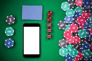 Mobile phone on casino poker table