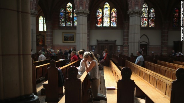 People pray during a special Mass in memory of the victims of Malaysia Airlines Flight 17 on July 20 in Hilversum, Netherlands.  (from CNN)