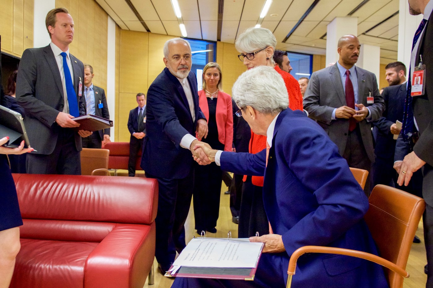 Secretary Kerry shakes hands with and bids goodbye to Iranian Foreign Minister Zarif at the Austria Center in Vienna, July 14, 2015, after Zarif read a declaration of the nuclear agreement in his native Farsi. (State Department)