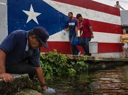 PR flag w toting water buckets - Would Emergency Water Systems Help In Puerto Rico?