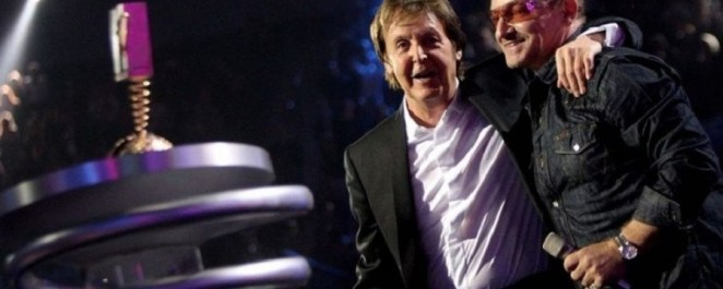 Paul McCartney  and Bono hugs each other during a live performance | Photo credit: Therichest.com