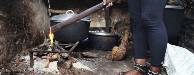 Getting the wood ready for breast ironing. Cameroon has a tradition of forcibly flattening young girls' breasts using a hot stone in the hopes of averting sexual advances