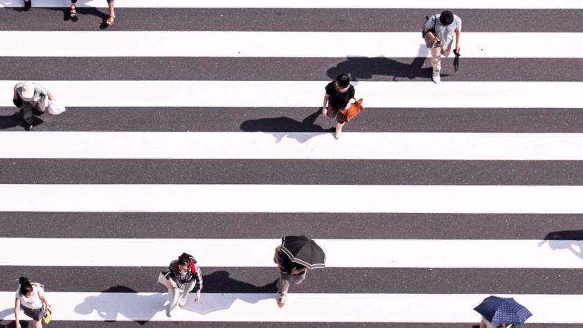 People walking across an intersection
