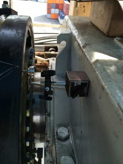 New equipment including drum coupling being installed and aligned.